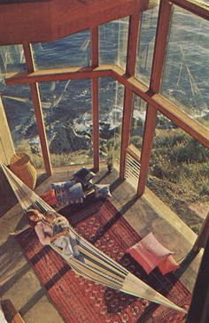 Indoor hammock in a room of windows