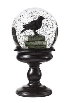 "The magic of snowglobes gets bewitched with this piece of tabletop #Halloween decor. Simply shake the #MarthaStewartLiving Crow Snowglobe to send spooky black ""snow"" whirling."