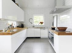 white and wood kitchen - not sure about wooden counters, not practical. But wooden shelves would work!