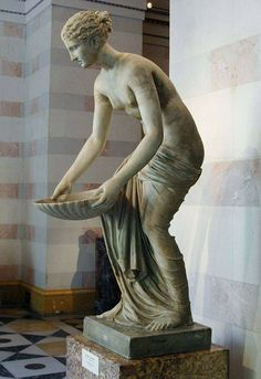 Nymph holding shell, Roman statue (marble), part of fountain, 1st century BCE, (The Hermitage, St Petersburg).