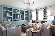 White and gray living room with blue accents
