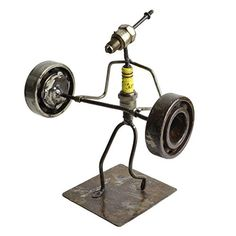 Artisans in Ougadougou, Burkina Faso, turn recycled spark plugs into whimsical sculptures. This cute little power lifter is showing off his brute strength, and makes the perfect gift for fitness enthu