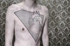 Strikingly 3D geometric tattoos