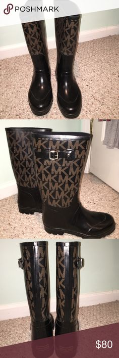 "MICHAEL KORS tall black logo RAIN BOOTS No longer available In store MICHAEL KORS tall waterproof rubber boot with logo embellishment & buckle hardware detailing on top. Worn a few times no noticeable marks. Good condition.  Perfect for a rainy or snowy day!                                                                     Size: US 8.5  1"" heel 10 1/2"" boot shaft; 15"" calf circumference. Removable insole. Pull-on style. Rubber upper/textile lining/rubber sole. By MICHAEL Michael Kors…"