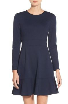 Free shipping and returns on Eliza J Ruffle Hem Stretch Fit & Flare Dress at Nordstrom.com. Simple in concept yet brilliantly flattering, this finely knit day dress is slimming with its sleek high-set waistband. The trumpet-style hemline adds flounce to highlight the leg while still keeping with the minimalist theme.
