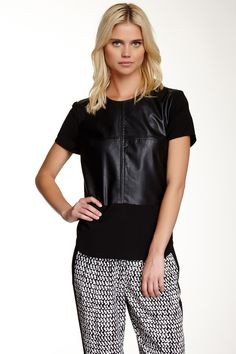 """The Luxe Leather Tee T-shirts and tanks are givens for layering under sweaters and cardis in the fall, but a leather shell can really take the concept to the next level. """"During my last shopping trip, I picked up a black leather tee,"""" says Sweatt. """"I plan on layering it with plaid tops and oversized sweaters to up the glam factor in my casual-dressing game.""""Ro&De tee. Shop similar styles at Nordstrom Rack."""