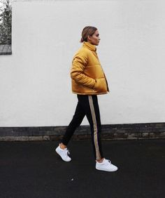 This yellow down-filled jacket is definitely an eyecatcher.