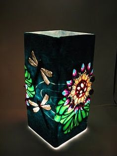 "Not sure where to put this, but I LOVE the water lily on this!  From previous pinner:  ""Awesome polymer clay work on this lamp !"""