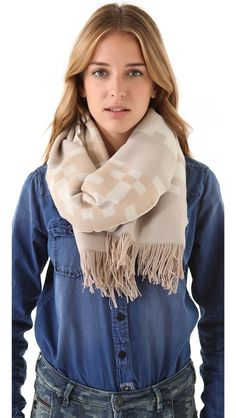 Pendleton, The Portland Collection Scarves / Wraps DESCRIPTION A neutral-toned pattern looks soft and sophisticated on a thick wool scarf. Fine fringe trims the edges.    100% virgin wool.  Dry clean.  Made in the USA.    MEASUREMENTS  Width: 20in / 51cm  Length: 68in / 173cm    $118