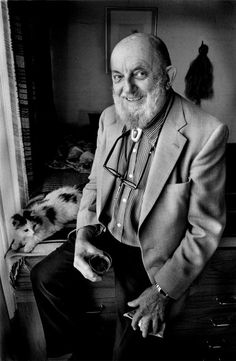 Ansel Adams, with feline fan, at a cocktail party in Tucson, 1980