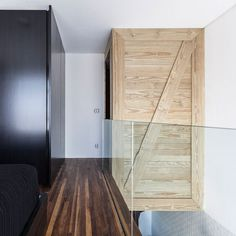 Pinewood Panels And Dark Wood Floor Also Glass Railing Panels Of Contemporary Interior Design: Chic Modern Small Apartment In Sao Paulo by Alan Chu