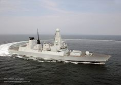 HMS Daring, the Royal Navy's first Type 45 Destroyer pulls a tight turn at sea following acceptance trials into service.