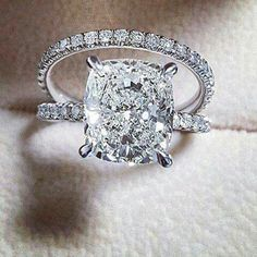 Beautiful cushion cut engagement ring paired with a pave wedding band.