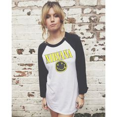 Vintage Style Nirvana Baseball Jersey T-Shirt ($22) ❤ liked on Polyvore featuring tops, t-shirts, silver, women's clothing, silver top, vintage style t shirts, baseball jersey top, vintage style tops and silver t shirt