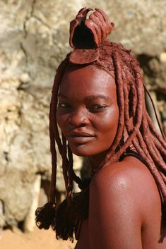 Himba Woman with hairstyle denoting that she is married. Himba women add an elaborate animal skin headdress to their hairstyle