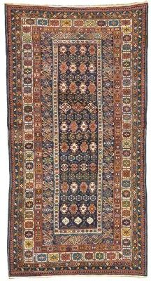 Chi-Chi rug , date cartouches at one end, (AH 1333, 1914 AD), --312cm. x 160cm.(10ft.3in. x 5ft.3in.) I Christie's Sale 9302