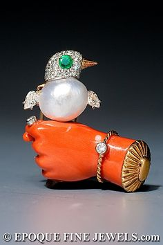 Cartier - An amusing emerald, diamond, coral and pearl novelty clip brooch for Mary