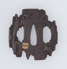 Tsuba in the form of a piece of rotten driftwood. Edo period Late 18th–early 19th century - Hamano Noriyuki II (Japanese, 1771–1852), Hamano School  http://www.mfa.org/collections/object/tsuba-in-the-form-of-a-piece-of-rotten-driftwood-11752