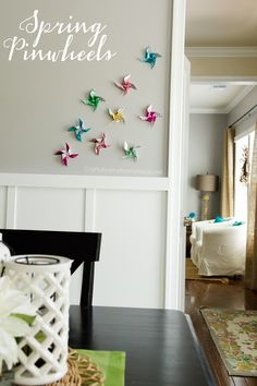 Spring pinwheels tutorial. Add happy little pinwheels to corners in your home for a Spring feel!