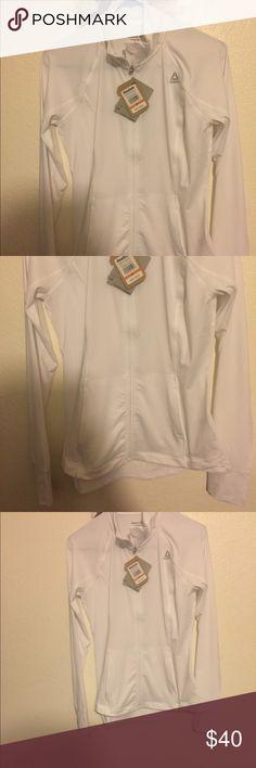 Reebok Athletic fabric White Zip-Up Brand new, still has tags, has thumb holes, size medium!! Reebok Sweaters
