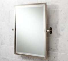 """Covington Pivot Mirror, Rectangle, Polished Nickel finish  $199.00    #    Clean lines of polished metal create this mirror's simple frame, designed with adjustable brackets so you can find the perfect angle.        * 21.5"""" wide x 3"""" deep x 24"""" high      * Sturdy wall brackets allow you to adjust the angle.      * Thickly plated beveled mirror is framed in aluminum for unrivaled strength.      * Available in chrome, polished nickel, and satin nickel finishes.      * Mounting hardware…"""