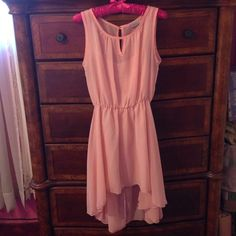 Pretty Pink High-low Sheer Dress with Slip Sheer Pink high-low dress with a pink slip. Front has a small keyhole and back has a long keyhole held at the top with a pretty jewel button. UVA Dresses High Low