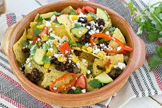Loaded Veggie Nachos with Portabella Mushroom Meat  The mushroom meat looks delish! Would probably be good in other recipes too. Lots of other vegetarian recipes on this blog too!