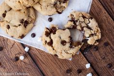 These Dairy Free Gluten Free S'mores Cookies are perfectly chewy and gooey, loaded with mini chocolate chips and marshmallows. They'll bring you to a campfire, without the smoke!