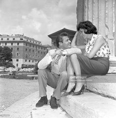 Roger Moore and Italian actress Luisa Mattioli having a break from the shooting the film 'Romulus And The Sabines.' Rome, 1961.