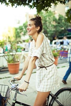 sexiness is riding a bike in a cut-out dress, your hair in a topknot, beaming your biggest, brightest smile. #oneforthelifelist