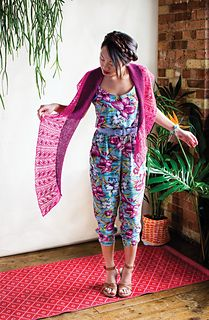 Baya, a crescent-shaped shawl with a lace and cable edge in lace weight