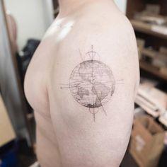 Single needle planet earth tattoo on the left shoulder. Tattoo artist: Hongdam