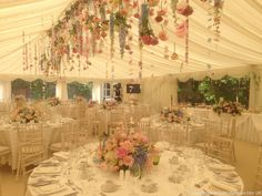 that hanging rope of flowers is damn good... damn good.... theres gotta be a way to incorporate that in the yard.... Gallery | American Marquee Hire UK
