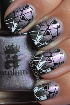 gradient over gradient: white to black geometric pattern stamped over black to light purple holographic gradient manicure