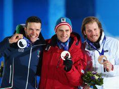 (L-R) Silver medalist Christof Innerhofer of Austria, gold medalist Matthias Mayer of Austria and bronze medallist Kjetil Jansrud of Norway celebrate on the podium during the medal ceremony for the Alpine Skiing Men's Downhill