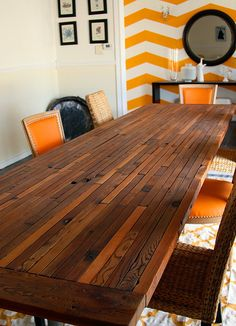 This reclaimed dining table is all kinds of amazing. (And a bonus love is that back wall of orange and white!)