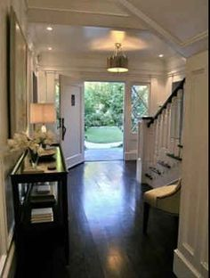 Dark wood flooring and stairs are so elegant and sleek!! I love them