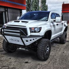 Lifted Toyota Tundra with armored front bumper Toyota Tundra Trd Pro, Lifted Tundra, Toyota 4x4, Toyota Trucks, Toyota Cars, Toyota Hilux, 4x4 Trucks, Toyota Tacoma, Custom Trucks