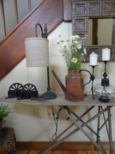 http://www.thelongawaitedhome.com/2012/08/antique-ironing-board-entry-table.html