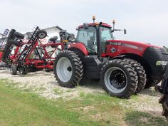 CaseIH Magnum 315 with 25th Anniversary sticker.Behind is the 330 Turbo True Tandem disk
