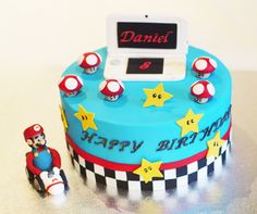 Nintendo DS cake Mario cake A friend saw a cake on flickr she loved by user Drakegore (who has some gorgeous cakes ... loved the campervan) and asked us to make a version for her son. Original at http://www.flickriver.com/photos/40152129@N06/5097711995/