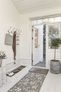 I would love to somehow separate a horizontal white washed wood planked floor in the kitchen from stained barn wood floors in a herringbone pattern in the living room and hallway. That would be awesome. But realistically, We probably would just keep the hallway, kitchen and living room all the same flooring. Less work.