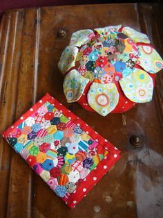 matching hand sewn, tiny patchwork needlebook and pin cushion by duniris, via Flickr