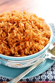 Easy Spanish Rice ~ cook a pot of rice using chicken broth, tomato sauce, and a few seasonings to make this quick and easy Spanish Rice...it's the perfect base for rice bowls or a delicious side dish to your favorite Mexican entrees!   FiveHeartHome.com
