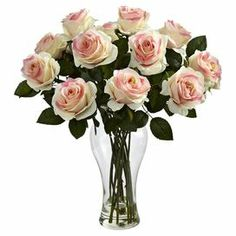 """Faux rose arrangement in a glass vase.   Product: Faux floral arrangementConstruction Material: Silk and glassColor: Light pinkFeatures:  Liquid illusion faux waterFaux rosesVase included Dimensions: 18"""" H x 13"""" Diameter"""