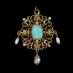 The Wild jewel - England, circa 1590s. Pendant jewel in gold and enamel set with diamonds and rubies, enclosing a turquoise cameo of Elizabeth I and hung with pearls.