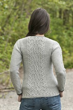 The Graceful Cabled Tunic is a lightweight pullover with a unique neckline (an open keyhole) and with cabled panels down each sleeve and in the center of the front & back pieces.