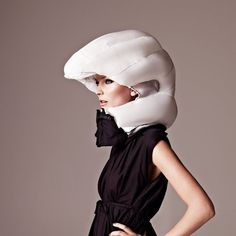 "Hövding Invisible Bicycle Helmet - ""Changing the way cyclists view safety and style with an innovative airbag hood"" that auto-inflates when it detects an accident."