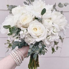 Ignore the fact that my arm is about he same color as this beautiful monochromatic bridesmaid's bouquet.  #westviewflorist