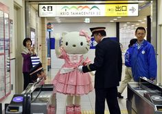 Turning 40 and as cute as ever: A human-size Hello Kitty greets passengers at a Tokyo rail station. Hello Kitty, Japan's global icon of cute, celebrated her 40th anniversary.  Photo: Yoshikazu Tsuno, AFP/Getty Images